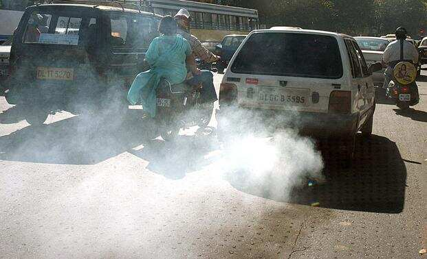 Pollution: An old car releases excess smoke in Delhi.